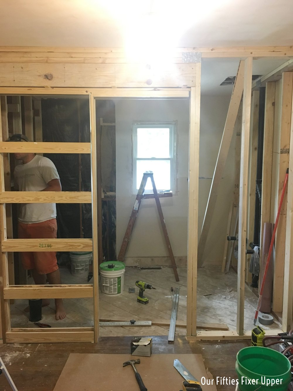 Wall between closet and bathroom framed in
