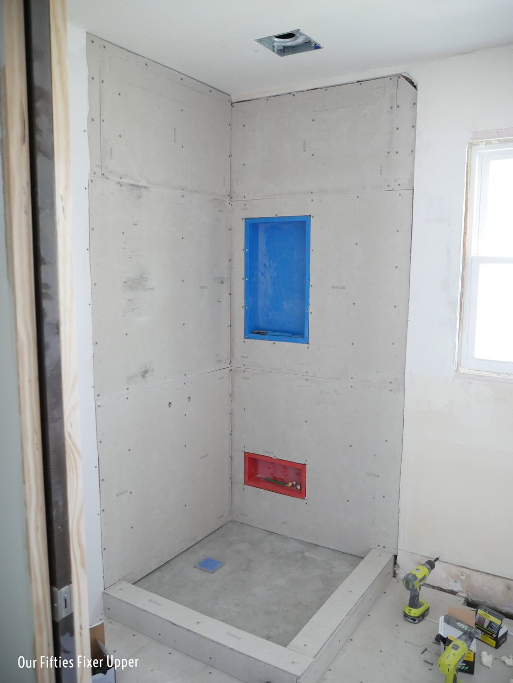 Shower pan with fiber cement walls