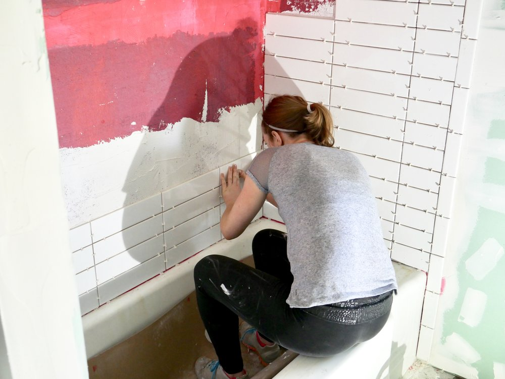 tiling the tub- our fifties fixer upper