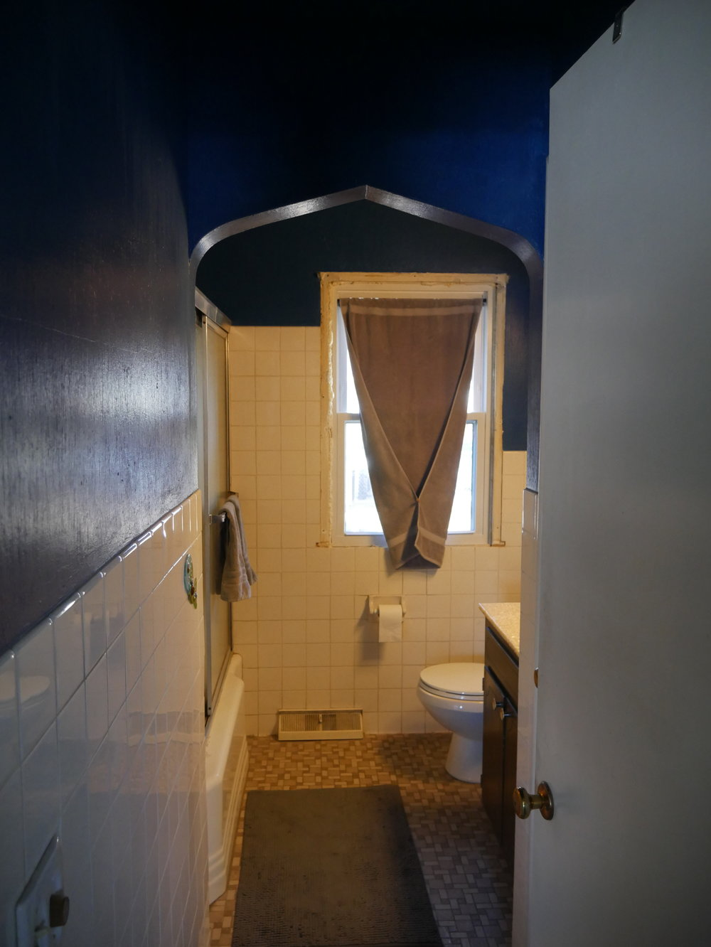 getting rid of that archway made the bathroom feel twice as big!