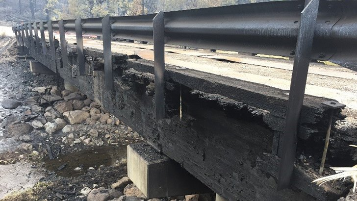 A glimpse of the same bridge after wildfire moved through the area. (USDA photo by Chris Bielecki)