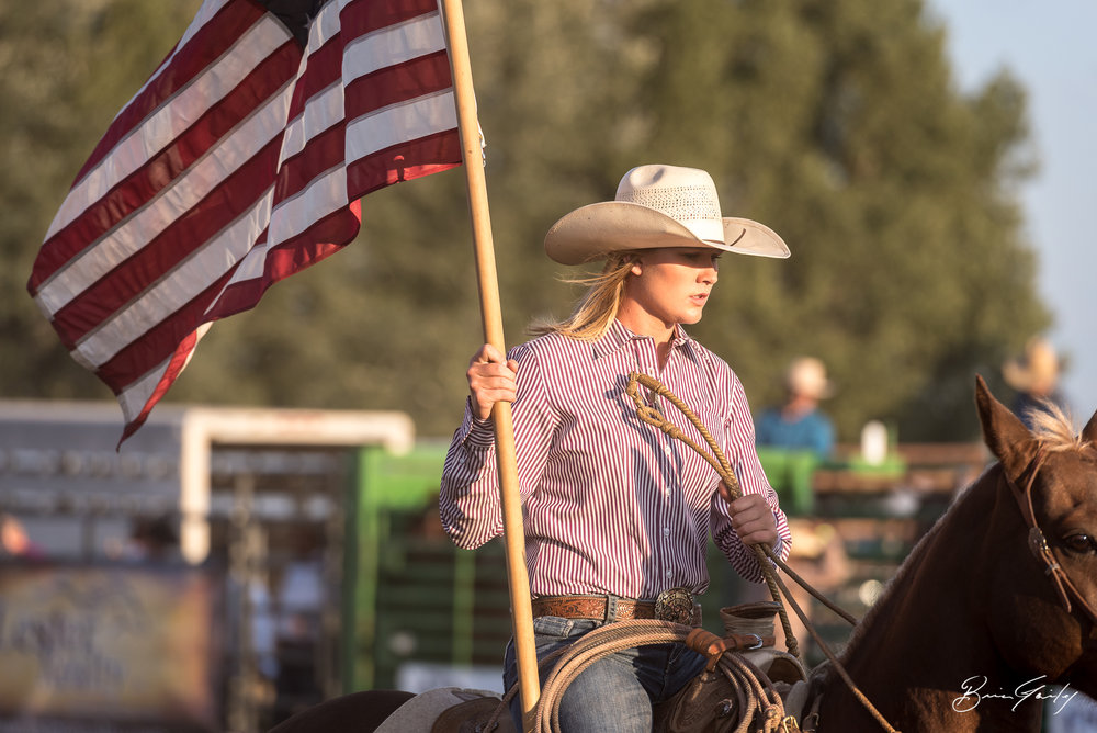 There is just something about watching Old Glory doing laps on the back of a horse as our National Anthem plays.  Image:  Brian Gailey  Tulelake Butte Valley Fair 2017