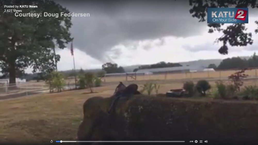 A single frame from a video by Dough Feddersen and KATU showing a funnel cloud that was later confirmed to be a tornado hitting a dairy farm in Lebanon, Ore.   Watch the full video at -  https://www.facebook.com/katunews/videos/10155073699581448/    KATU News