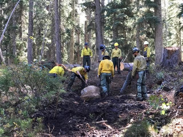 The Black Hills Crew and Resource Advisors work together to rebuild damage riparian areas on the North Pelican Fire