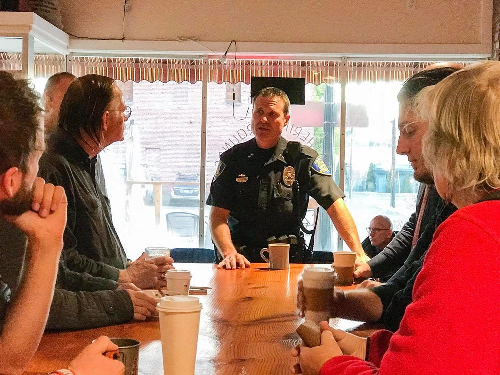 Chief Henslee speaks with a small group of Klamath Citizens at Gathering Grounds Roastery during Coffee with a Cop. (Brian Gailey)