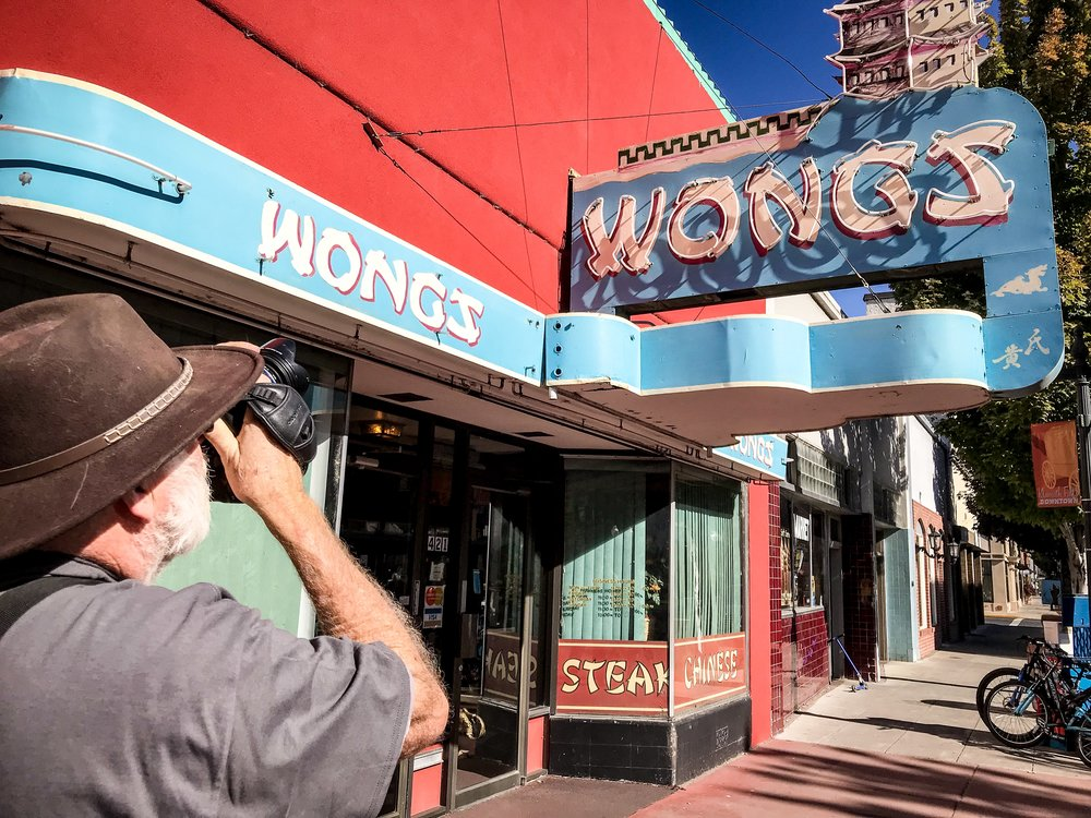 Participant, Russell Gaughen captures an image of the Wong's neon sign on Main Street in Downtown Klamath Falls. (Brian Gailey)
