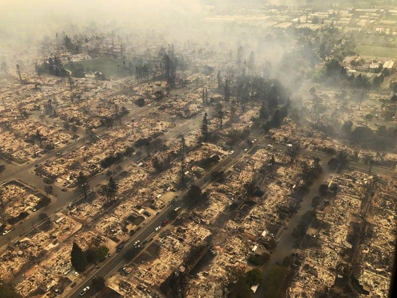 This aerial photo provided by the California Highway Patrol Golden Gate Division shows some of hundreds of homes destroyed in a wind-driven wildfire that swept through Santa Rosa, Calif., early Monday, Oct. 9, 2017. (California Highway Patrol Golden Gate Division via AP)