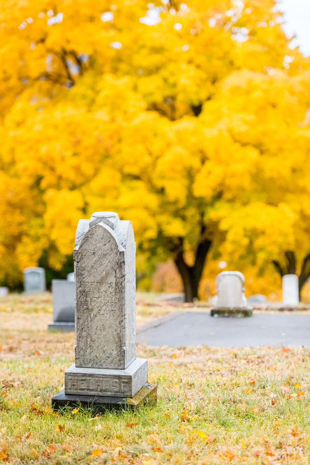 The tombstone of Fredrick Melhase (1852-1915) is seen here in the Linkville Cemetery during the peak of the fall color season in Klamath Falls. Image: Brian Gailey