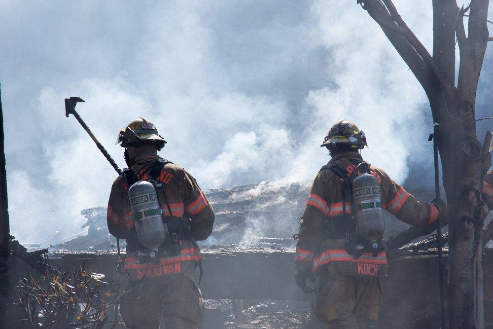 Firefighters monitor hot spots in a blaze. (File Photo, Benjamin Kerensa)