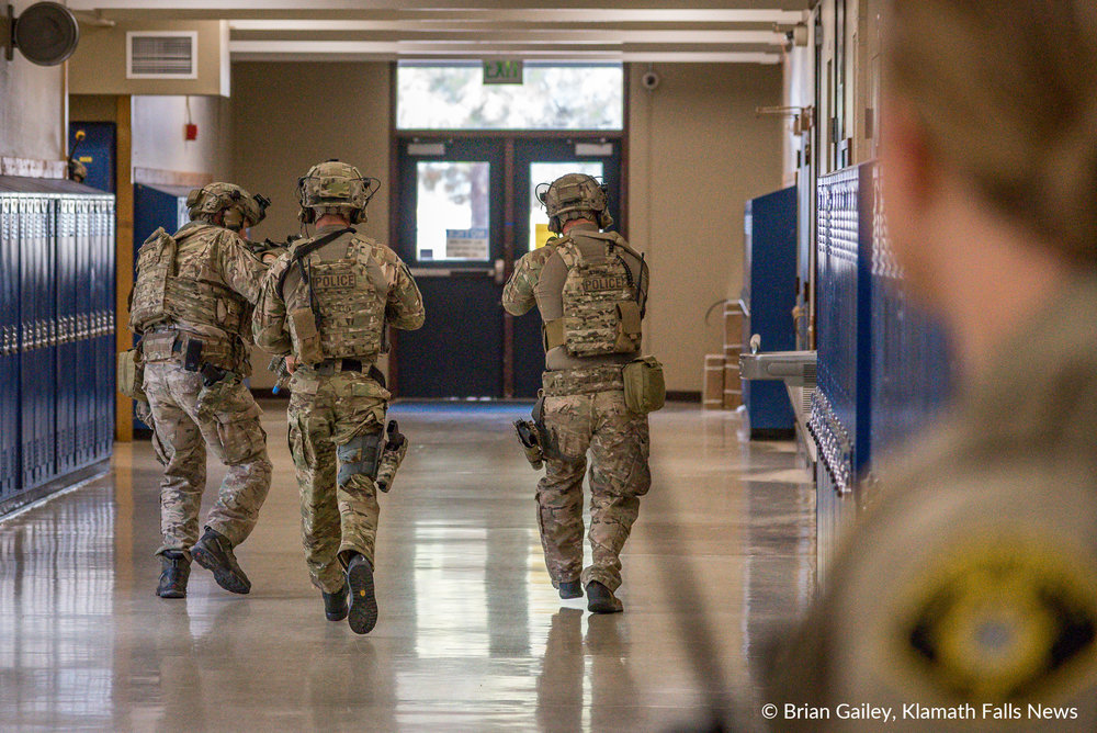 A Klamath Basin SWAT Team patrolls the halls of Henley High School during an Active Shooter Drill on November 9, 2017. (Image: Brian Gailey)
