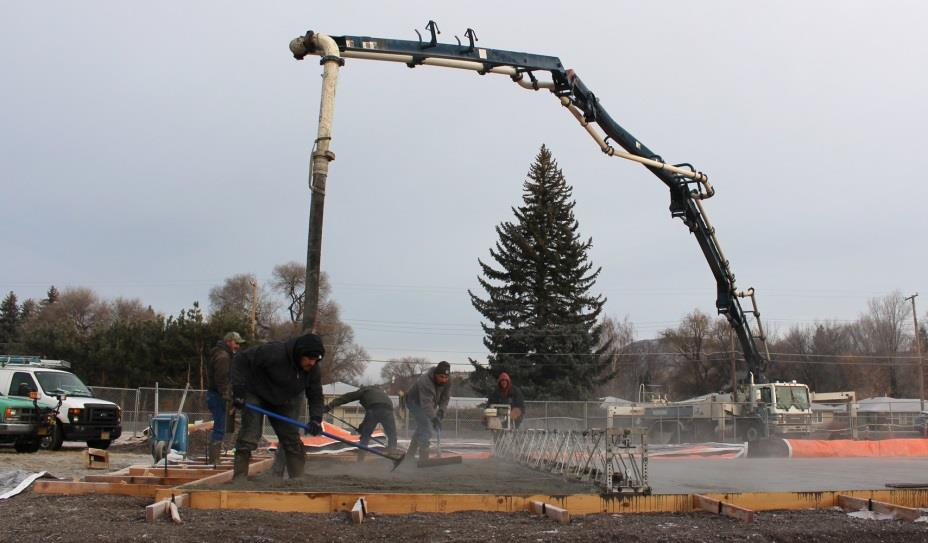 Workers spread concrete pumped from a truck to construct the foundation for the new classrooms at Peterson Elemtary School (Samantha Tipler, KCSD)