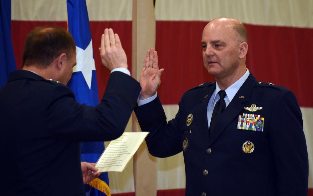 Brig. Gen. James R. Kriesel, incoming commander, Oregon Air National Guard, takes the oath of office during his promotion ceremony at the Anderson Readiness Center in Salem, Oregon, Jan. 6, 2018. (U.S. Air National Guard photo by Tech. Sgt. Brandon Boyd, 142nd Fighter Wing Public Affairs)