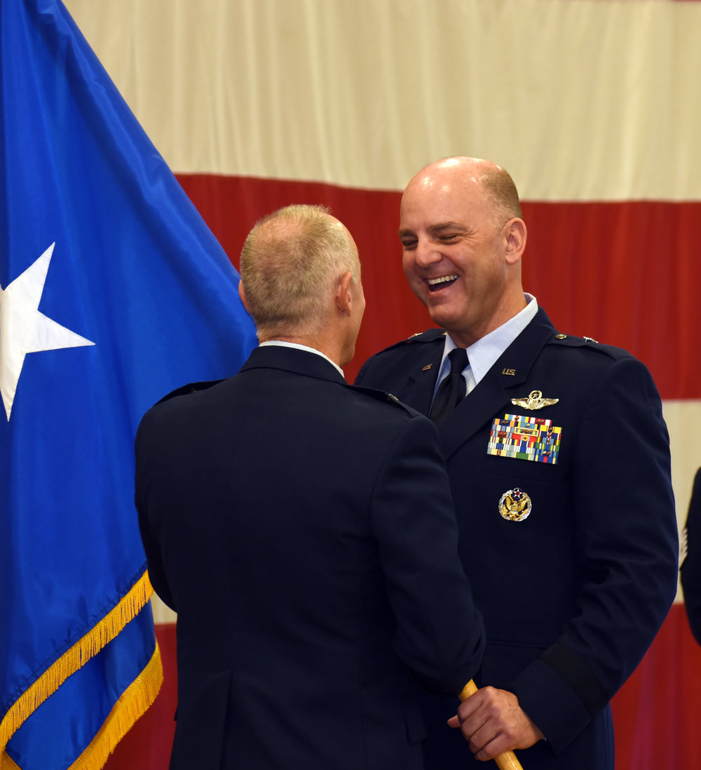 Brig. Gen. James R. Kriesel (right), incoming commander, Oregon Air National Guard, receives his one-star general officer flag from outgoing commander, Brig. Gen. Jeffrey M. Silver, during a promotion ceremony at the Anderson Readiness Center in Salem, Oregon, Jan. 6, 2018. (U.S. Air National Guard photo by Tech. Sgt. Brandon Boyd, 142nd Fighter Wing Public Affairs)