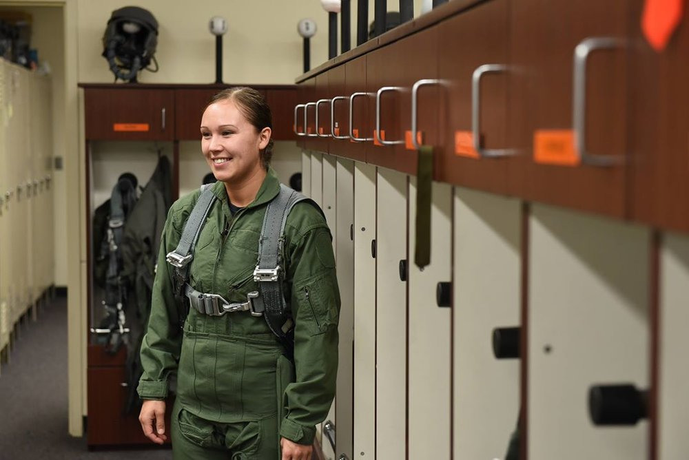 Klamath Falls Police Department Officer of the Year, Beads Yahwhee, smiles after getting fitted for a flight suit in preparation for an F-15 Eagle ride as a part of a new 173rd Fighter Wing program called Hometown Heroes. (U.S. Air National Guard photo by Tech. Sgt. Jefferson Thompson)
