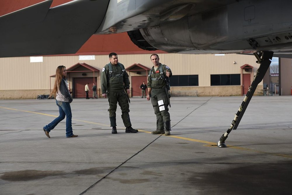 U.S. Air Force Maj. William Sullivan, an instructor pilot with the 173rd Fighter Wing, shows A.J. Davila, a local college adjunct professor and veteran's affairs advocate, around the aircraft prior to boarding for a civic leader flight, Jan. 3, 2018 at Kingsley Field in Klamath Falls, Ore. (U.S. Air National Guard photo by Tech. Sgt. Jefferson Thompson)
