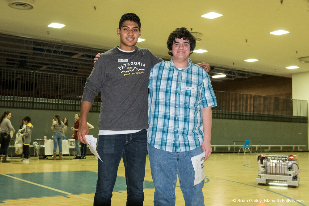 Mario Segura (left) and Matt Volpe (right) post for a photo near the end of the first annual STEMonstration held at Mazama High School. (Brian Gailey).