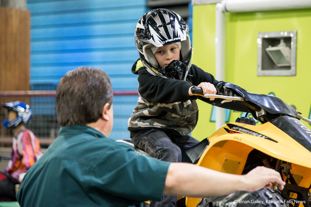 Keegan Basden is given instructions on how to properly ride an ATV from Oregon Parks and Recreation Department at PLAY Outdoors, Klamath Falls, Ore. - January 20, 2018 (Brian Gailey)