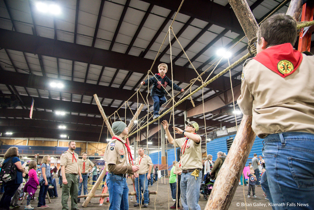 Hunter Stratton climbs across the Boy Scouts rope walk at PLAY Outdoors, Klamath Falls, Ore. - January 20, 2018 (Brian Gailey)
