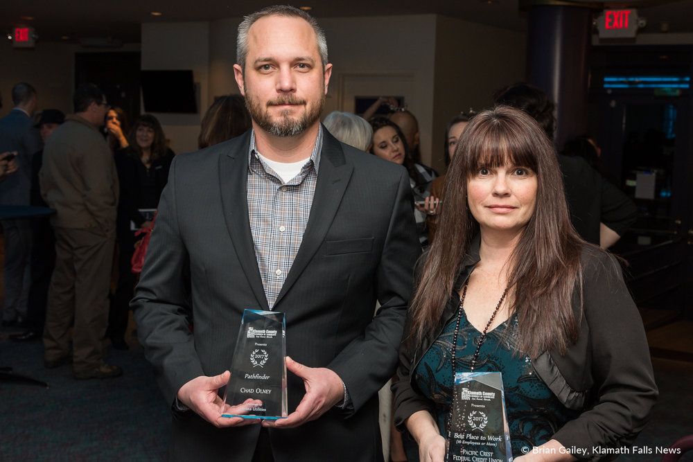 Chad Olney and a representative from Pacific Crest FCU stand with their awards following the 97th Annual Chamber Gala Awards. (Brian Gailey)