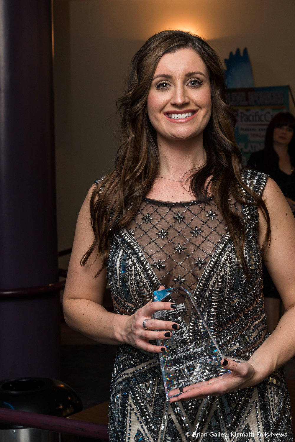 Chelsea Brosterhous stands with her award following the 97th Annual Chamber Gala Awards. (Brian Gailey)