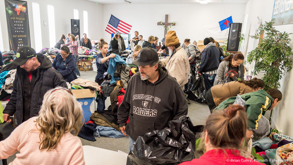 Dozens fill a room where clothing and blankets were being given away. Klamath Lake Community Action Services, Winter Give a Way. January 31, 2018. (Brian Gailey)