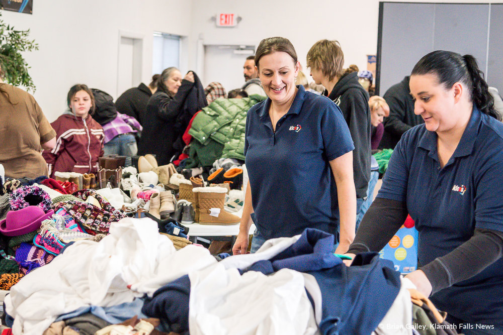 Volunteers sort and add more clothing as donations are picked up. Klamath Lake Community Action Services, Winter Give a Way. January 31, 2018. (Brian Gailey)