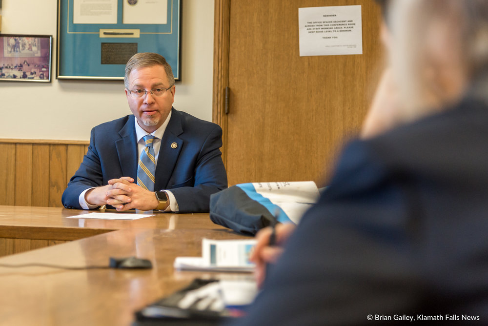 Representative E. Werner Reschke (R-District 56, Klamath Falls) Discusses issues with a delegation from Klamath Falls.