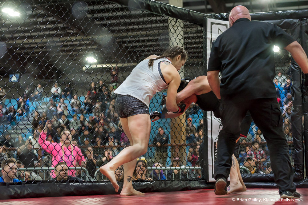 Fighters, Pony Howard and Charlie Wright battle inside the MMA Cage during Arena Wars at the Klamath County Fairgrounds. March 24, 2018 (Brian Gailey)