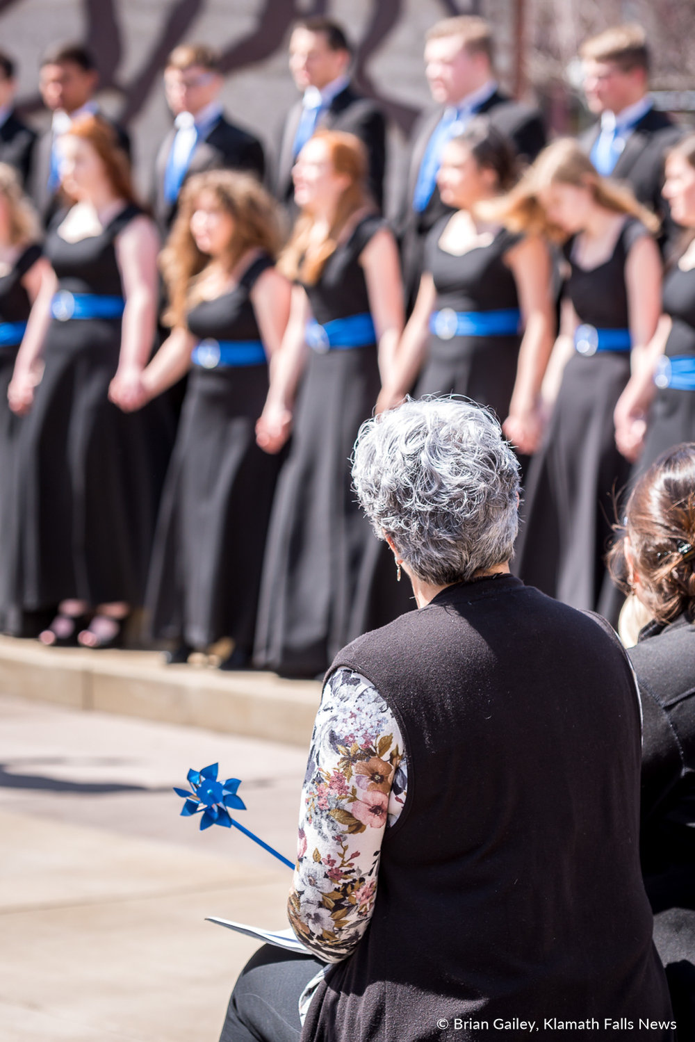 Klamath Falls Mayor, Carol Westfall watches as the Henley High School Touch of Class preforms in front of 200 at Sugarman's Corner in Downtown Klamath Falls to celebrate a Day of Hope. Hope that child abuse can be eradicated. April 4, 2018 (Brian Gailey)