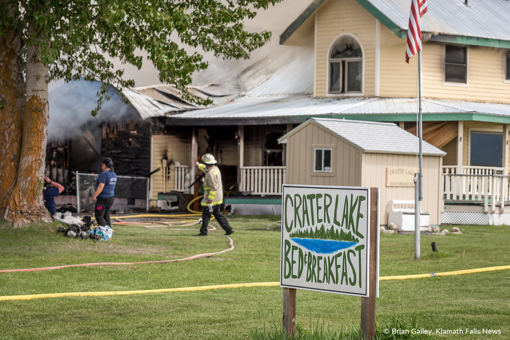 Firefighters work a blaze at the Crater Lake Bed and Breakfast. May 19, 2018. Image, Brian Gailey.