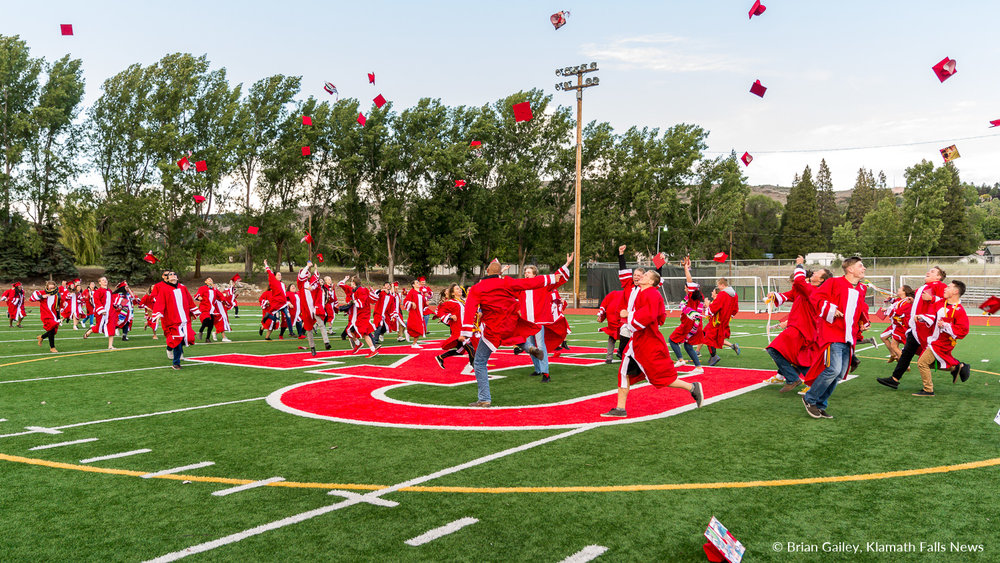 Keeping with tradition, the 2018 Senior Class celebrates mid field following the graduation ceremony. June 9, 2018 (Brian Gailey).