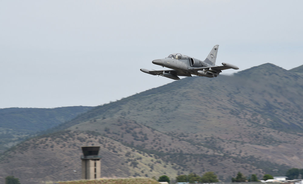 "A Draken International L-159E Honey Badger aircraft flies past a local Klamath County landmark, Mt. Stukel, as it undertakes the very first mission to provide ""red air"" during training missions for the 173rd Fighter Wing in Klamath Falls, Ore., June 5, 2018. This contract is slated to last for two months as the U.S. Air Force evaluates a more permanent integration in the summer of 2019 to help increase student pilot training for the air superiority mission in the F-15 Eagle. (U.S. Air National Guard photo by Tech. Sgt. Jefferson Thompson)"