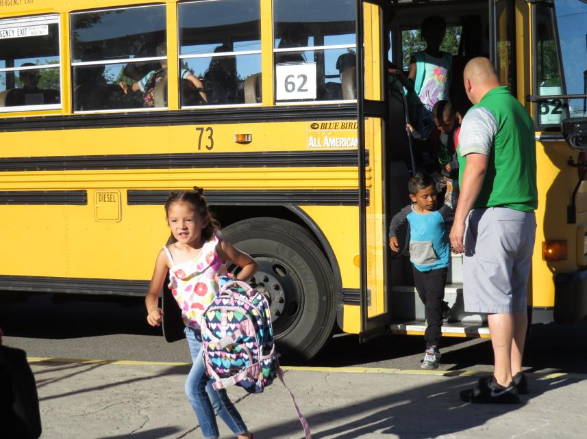 Yoselyn Torres Romero heads to class as Ruben Paschal, principal of KCSD migrant summer school, greets students exiting the busses in the morning. Nearly 190 students are enrolled this year for the 19-day program. The school is at Shasta Elementary this year.(Marcia Schlottmann, KCSD).