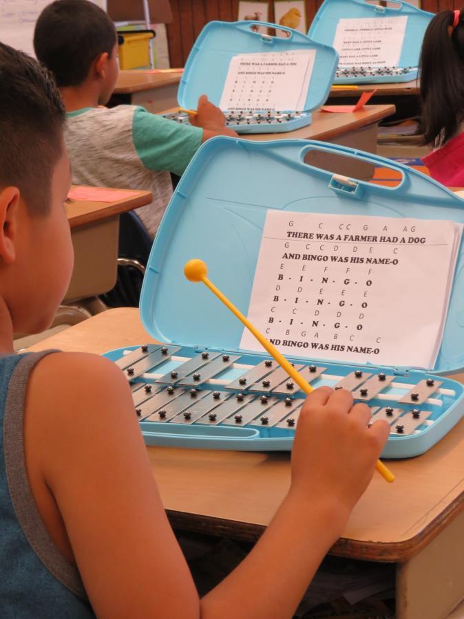 Giovanny Cortez-Ledezma plays xylophone as part of a second- grade class enrichment activity.(Marcia Schlottmann, KCSD).