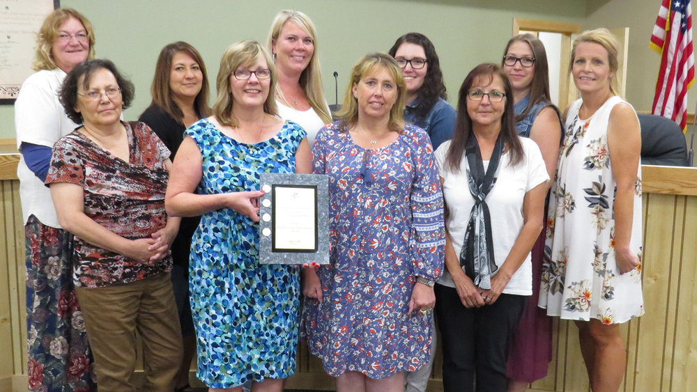 Members of the KCSD business office, from left to right, back row: Tamara Cosand, Rachel Murray, Nancy Drake, Annalise Milwrick, Misty Phelps and Lana Loney. Front row, from left: Tandi Meyjes, Renée Ferguson, Denise Reid and Oma Rowley. (Marcia Schlottmann, KCSD)