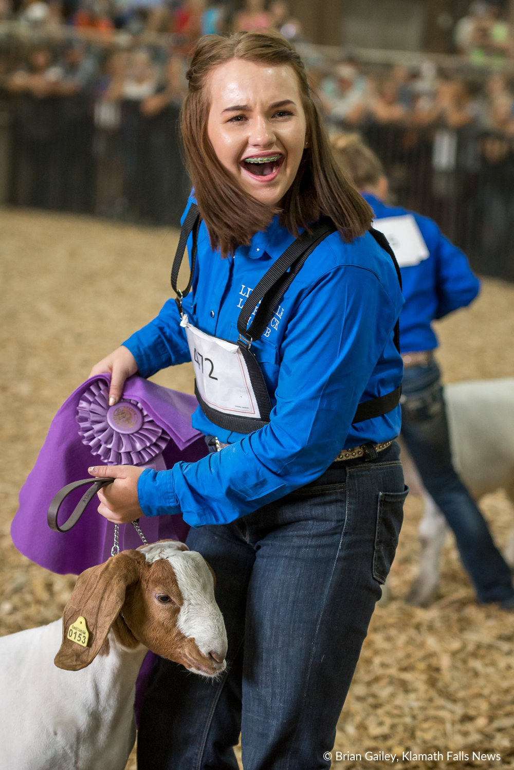 A participant is shocked to find out her goat is a Champion. August 3, 2018 (Brian Gailey)