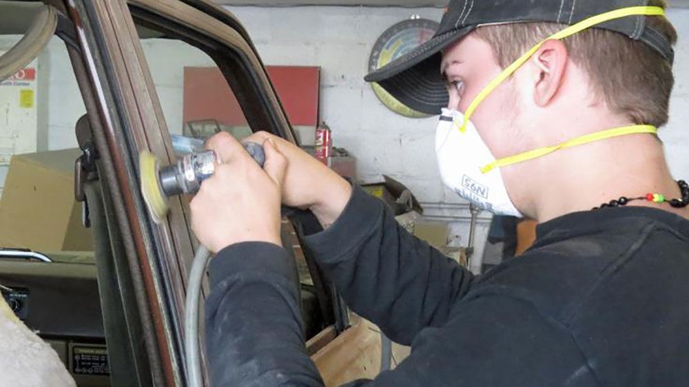 Derick Johnson, a sophomore at Mazama High School, sands the body of a Toyota Land Rover. He was an intern at Ken's Body and Paint for six weeks this summer as part of the Basin Partners Internship Program.