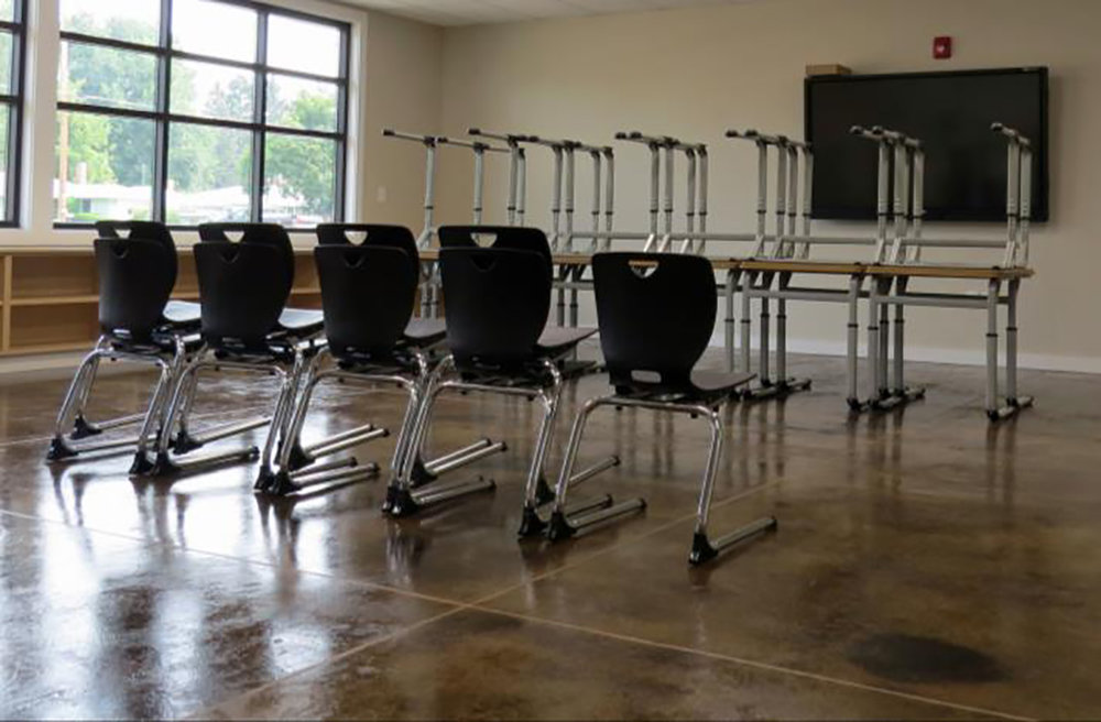 Classroom with new desks, chairs and SMART technology.