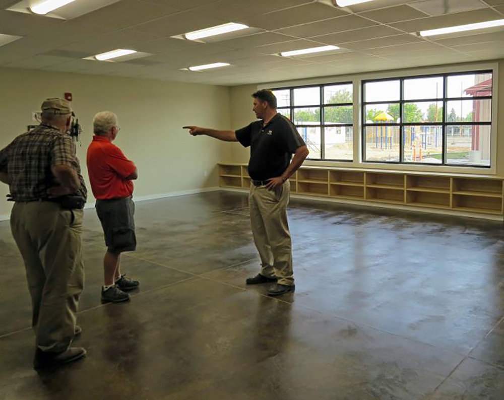 Justin Azevedo, maintenance supervisor and project manager for Klamath County School District, shows school board members the new classrooms at Peterson Elementary School.