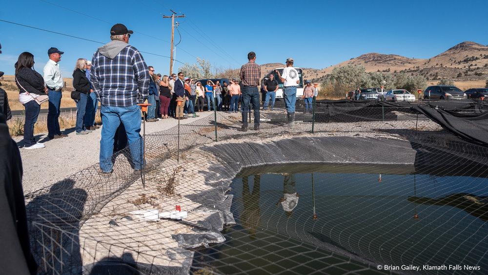 "Attendees of the 2018 Klamath Water Users Association Fall Harvest Tour visit ""Gone Fishing"" a sucker fish rearing program in Klamath Falls, Oregon. September 27, 2018 (Brian Gailey)"