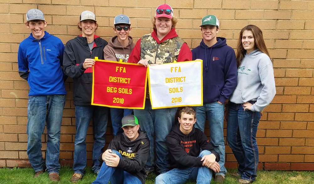 Bonanza FFA members show off their banners following the awards ceremony at the Southern Oregon District Soils Evaluation CDE Oct. 3. The chapter placed first as a team in the beginning and advanced contests.