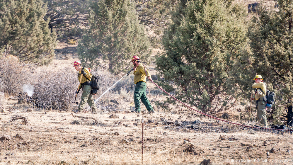 Firefighters work to extinguish spot fires on the Stukel Fire in Klamath County, Oregon. October 15, 2018 (Brian Gailey)