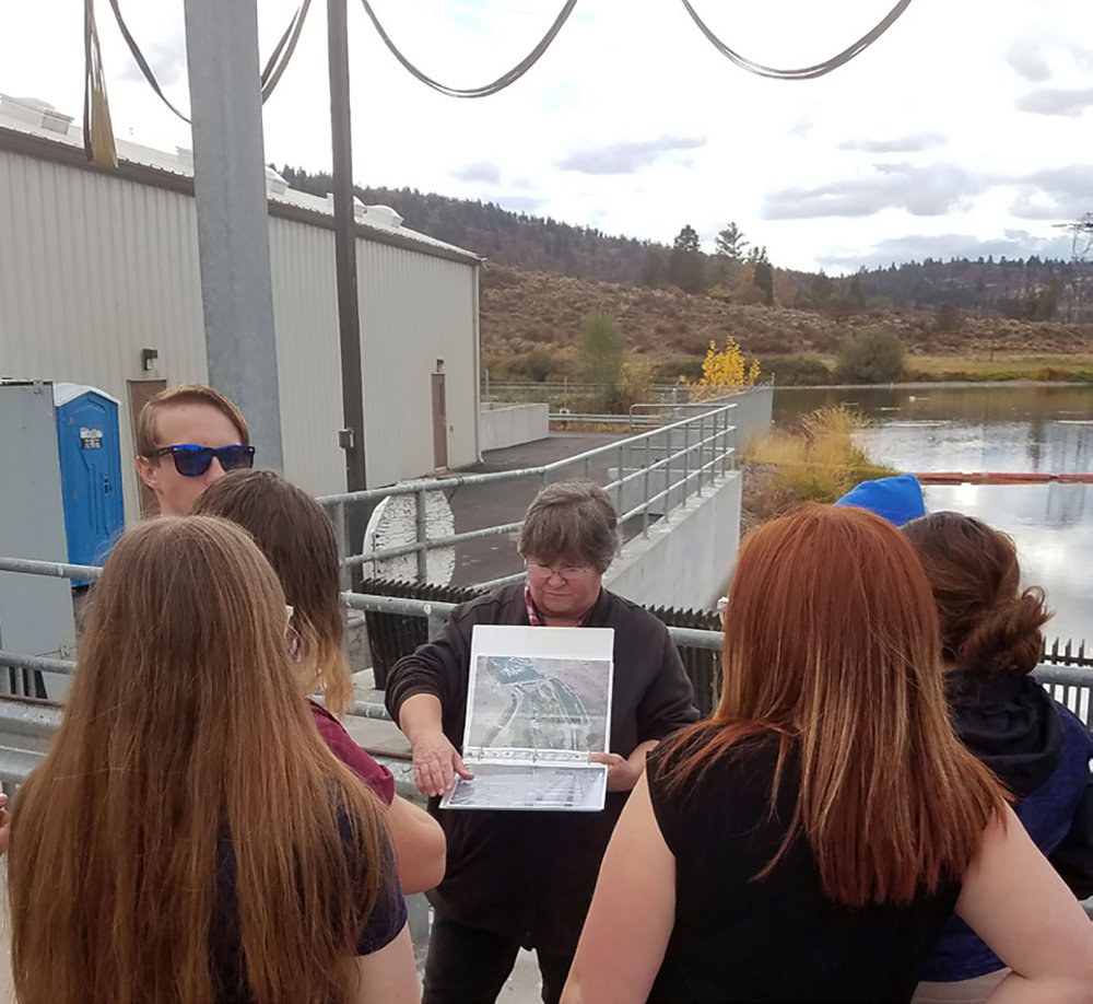 Sebastian Short, left, Charity Hamar, Brooklyn Mattson, JoAnna Henry and Daniela Garcia listen to a talk about the A-Canal head gates before taking a tour of the Link River Dam.