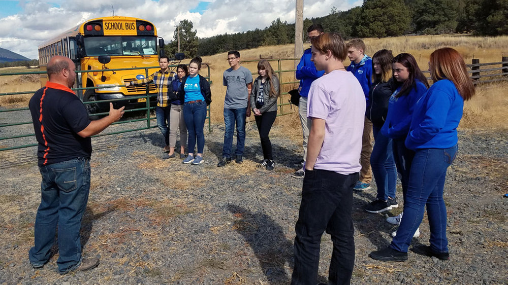 Rancher Jason Chapman explains how the ranch business works to Mazama FBLA students as part of a Leadership Klamath Youth daylong tour.