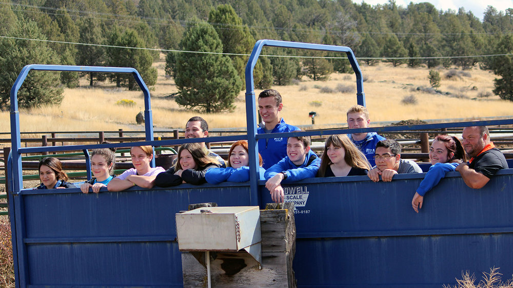 Mazama FBLA students pose with their teacher Sergio Cisneros and rancher Jason Chapman.