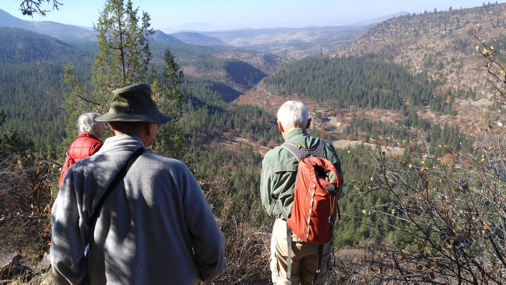 A history hike on Nov. 3 will explore long-abandoned wagon roads in the Klamath River canyon. This photo shows hikers on the same outing offered in October 2017. (Submitted Photo)