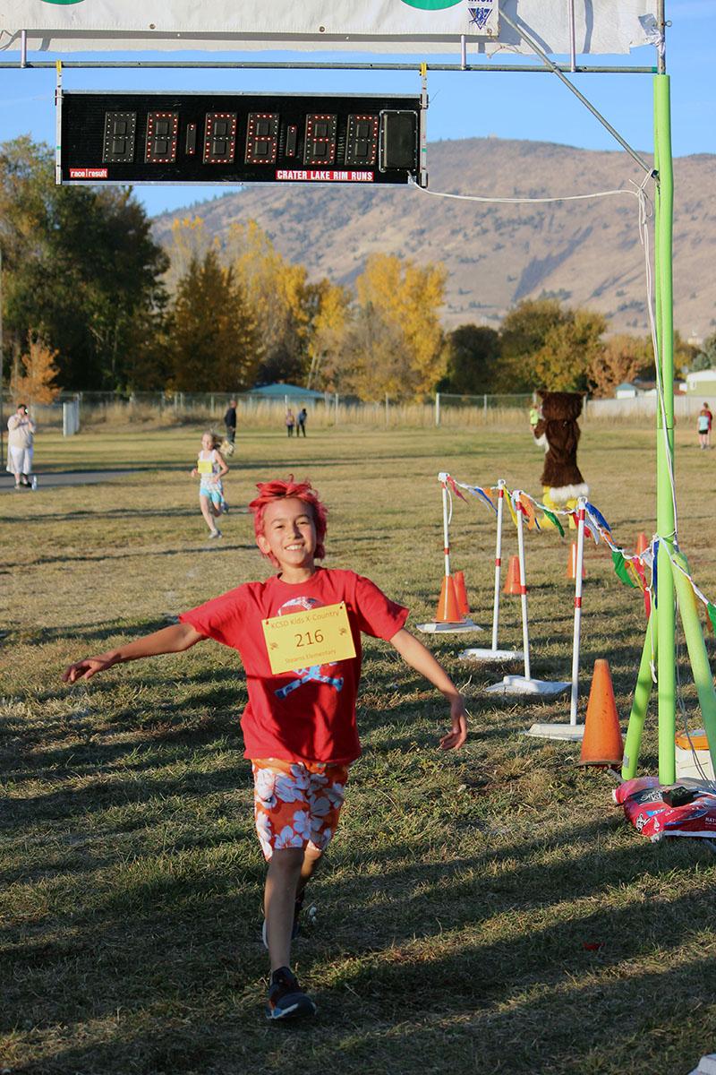 Tristan Foltz-Warrior smiles as he runs through the finish chute.