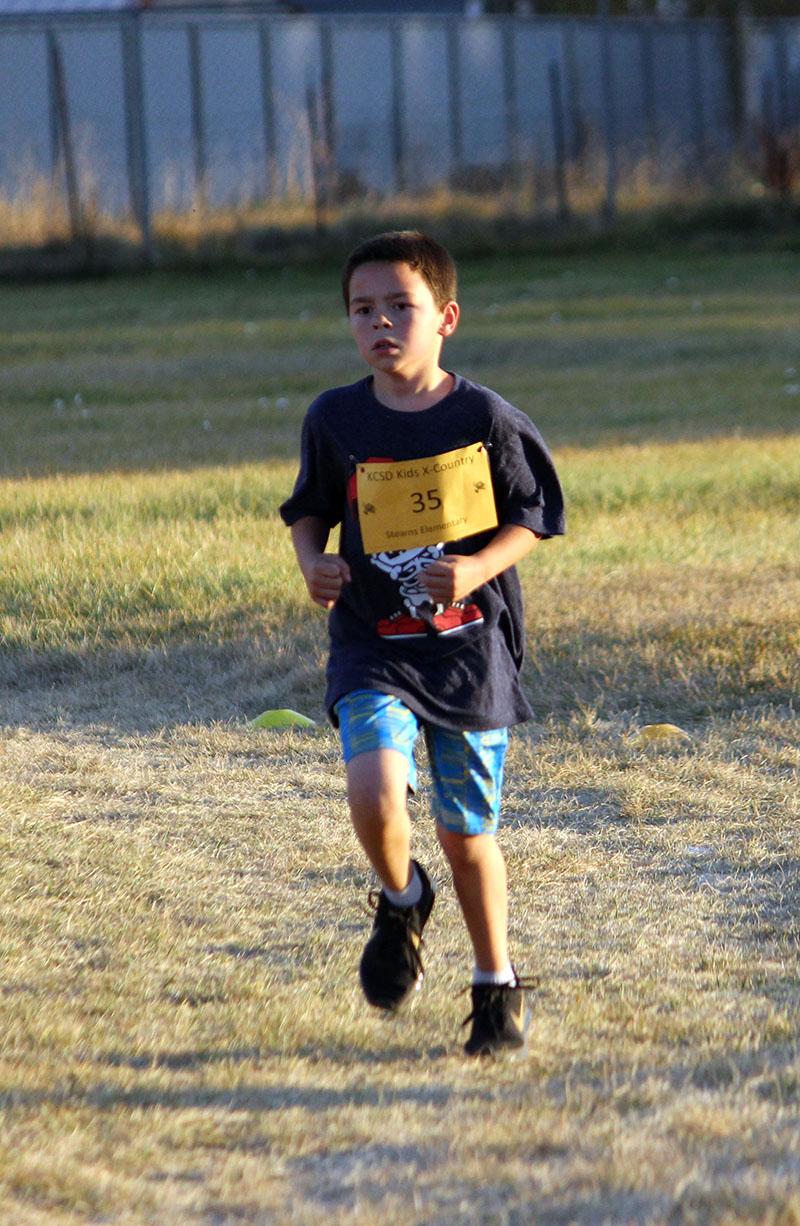 Second-grader Kooper Kessler runs in the one-mile race.
