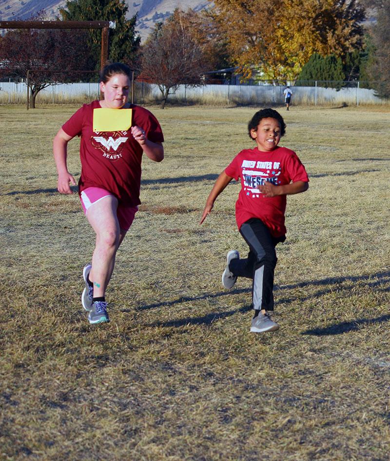 Lizabeth Henderson and Jaxson Harris race towards the finish line