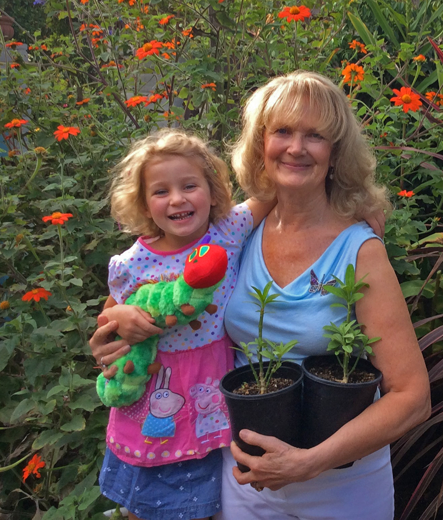 Cathy Fletcher (right) and her grand-daughter Eva in their Santa Barbara, California pollinator garden. Monarch B6679 was discovered in her garden last September after flying 545 miles from Klamath Falls, Oregon. Photo provided by Cathy Fletcher